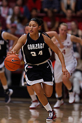 Nov 13, 2011; Stanford CA, USA;  Gonzaga Bulldogs guard Jazmine Redmon (34) dribbles the ball up court against the Stanford Cardinal during the first half at Maples Pavilion.  Stanford defeated Gonzaga 76-61. Mandatory Credit: Jason O. Watson-US PRESSWIRE