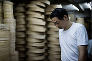 Lam Ying-hung works on hand made Dim Sum steamers at the Tuk Chong Sum Kee Bamboo Steamer Company in Western District of Hong Kong on June 25 2015, in Hong Kong, China. Bamboo steamer makers were once commonplace in Hong Kong but, in the 1980's, almost all production moved to the mainland. Lam's company, located in the Western district of Sai Ying Pun, is the last one left in Hong Kong. Photo by Xaume Olleros