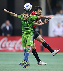 July 15, 2018 - Atlanta, GA, USA - Seattle Sounders midfielder Victor Rodriguez and Atlanta United defender Michael Parkhurst collide on a header during the second half on Sunday, July 15, 2018, in Atlanta, Ga. (Credit Image: © Curtis Compton/TNS via ZUMA Wire)