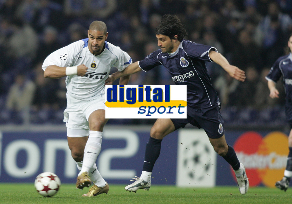 """PORTUGAL - PORTO 23 FEBRUARY 2005: RIBEIRO ADRIANO LEITE #10 and PEDRO EMANUEL dos Santos #3, compete for the ball, First Knock-out Round First Leg of the UEFA Champions League, match FC Porto (#) vs FC Internazionale (#), held in """"Dragao"""" stadium  23/02/2005  19:46:29<br />(PHOTO BY: NUNO ALEGRIA/AFCD)<br /><br />PORTUGAL OUT, PARTNER COUNTRY ONLY, ARCHIVE OUT, EDITORIAL USE ONLY, CREDIT LINE IS MANDATORY AFCD-PHOTO AGENCY 2004 © ALL RIGHTS RESERVED"""