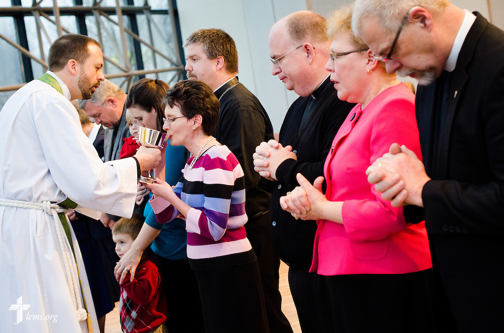 The Rev. Edward Grimenstein, associate executive director of LCMS Office of International Mission, distributes the Sacrament to Suzanne Kaster on Friday, Feb. 14, 2014, at a Service of Sending at The Lutheran Church--Missouri Synod International Center in Kirkwood, Mo. LCMS Communications/Erik M. Lunsford