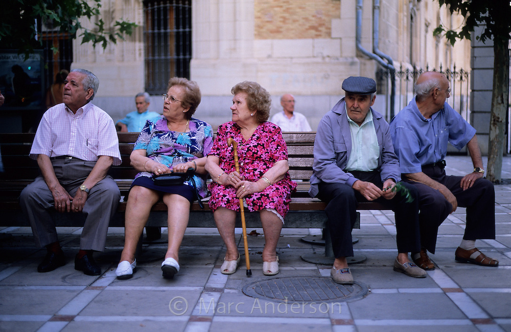 Elderly Spanish people sitting on a bench in central Jaen, Andalucia, Spain