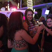 MIAMI BEACH, FLORIDA, NOVEMBER 4, 2016<br /> Revelers drink cocktails in The Clevelander Hotel in Miami Beach's popular Ocean Drive on a Friday night. Recent incidents of violence and crime are pushing the city of Miami Beach to try to alter the appeal of the area.<br /> (Photo by Angel Valentin/Freelance)