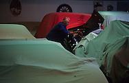cleaning the collection of cars of the prince. palace of Monaco. The Palace's garage. The chief mechanic, who ventured with the Prince on a tour de France in 1936, upkeeps the Prince's car collection. Rainier III owns eighty vintage automobiles: Rolls Royce, Bentley, etc. The cars will be united in a museum that will soon open its doors in Fontvielle.   Le garage du palais princier. Le chef mécanicien, qui a fait le tour de France avec SAS Rainier en 1936, entretient la collection de voitures du prince.Rainier 3 possède 80 voitures historiques, des Rolls, des Bentleys etc.. qui seront  rassemblées dans un musée qui va ouvrir ses portes à Fontvielle  288286/15    L921125b  /  P0000360