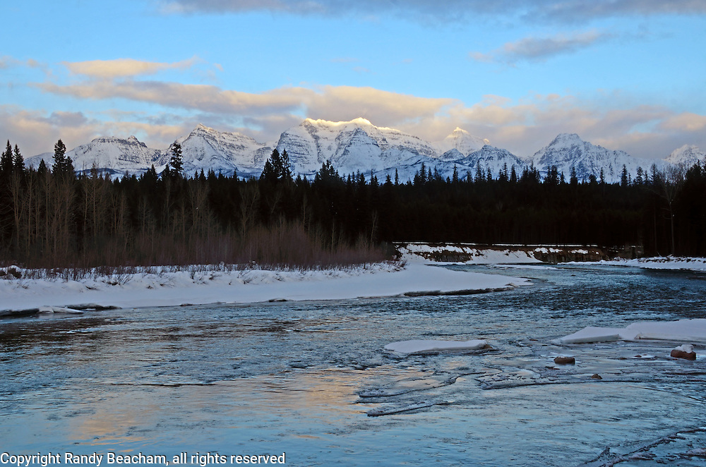 North Fork Flathead River and the Livingston Range at sunset in winter. Glacier National Park, northwest Montana.