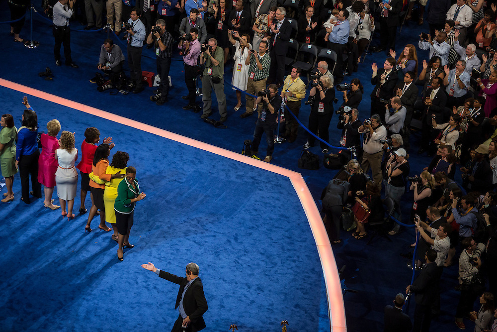 Female democratic members of Congress stand on stage at the Democratic National Convention on Tuesday, September 4, 2012 in Charlotte, NC.