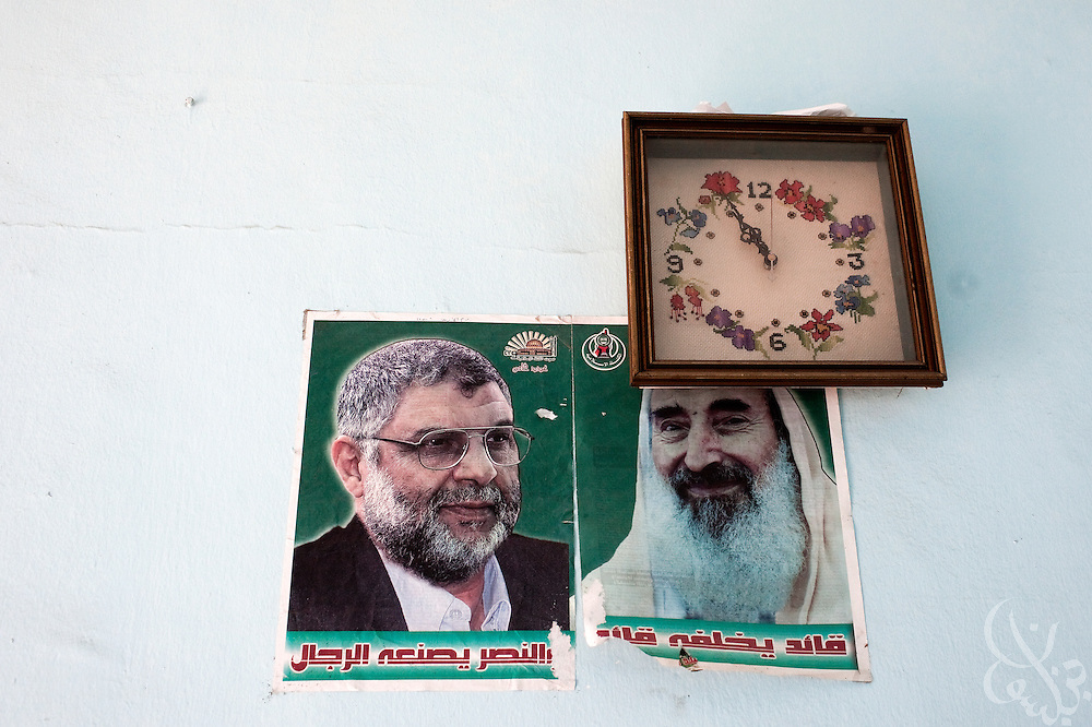 Posters of assassinated HAMAS leaders Sheik Ahmed Yassin (r) and Dr. Abdel Aziz al-Rantissi sit under a clock on the wall at the City of Arafat HAMAS Police headquarters December 20, 2009 in Gaza City, Gaza. On December 14, 2009 HAMAS celebrated its 22 anniversary.