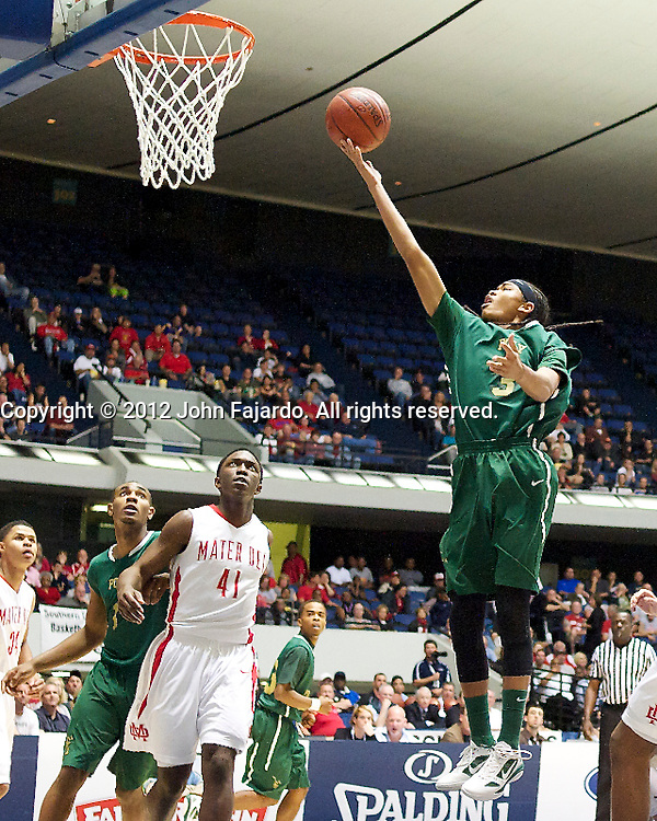 Poly's Joshua Munzon puts up the shot in the CIF Southern Section Boys Basketball Championship against Mater Dei at the Anaheim Convention Center, Sat., March 3, 2012.