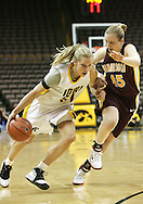 25 JANUARY 2007: Iowa forward Krista VandeVenter (51) tries to drive past Minnesota forward Leslie Knight (45) in Iowa's 80-78 overtime loss to Minnesota at Carver-Hawkeye Arena in Iowa City, Iowa on January 25, 2007.