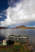 Lobster cage, Ballinakill Bay, Connemara, Galway, Ireland. With Tully Mountain in the background.