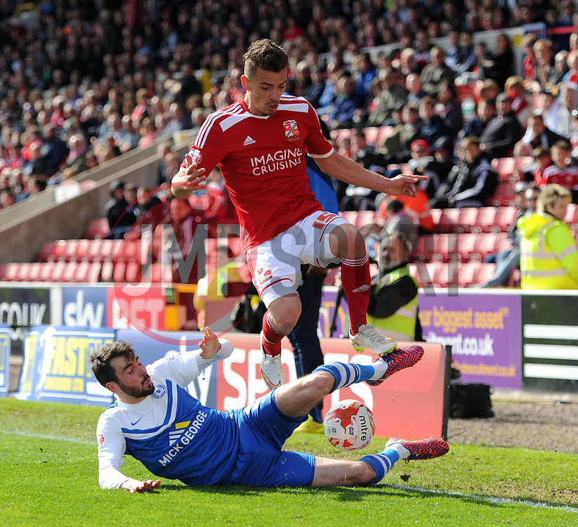 Peterborough United's Michael Smith tackles Swindon Town's Harry Toffolo - Photo mandatory by-line: Paul Knight/JMP - Mobile: 07966 386802 - 11/04/2015 - SPORT - Football - Swindon - The County Ground - Swindon Town v Peterborough United - Sky Bet League One