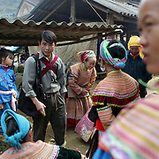 Visitors to the Lung Khau Nhin Market. Vietnam. Lung Khau Nhin Market is rural tribal market hiding itself amongst the mountains and forests of the far north Vietnam about 10 km from the border with China. The market plays an important role for the local ethnic people, Flower Hmong, Black Zao, Zay, and very small ethnic groups  Pa Zi, Tou Zi, Tou Lao. Tourist trips to the market run from Sapa and Lao Cai every week. Lung Khau Nhin Market, Vietnam.15th March 2012. Photo Tim Clayton