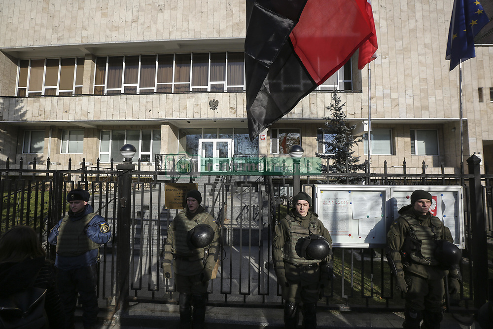 February 5, 2018 - Kyiv, Kyiv region, Ukraine - Activists of different nationalist parties protest against the bill about 'Bandera ideology' in front of Polish embassy in Kyiv, Ukraine, Feb. 5, 2018. Polish Sejm on 26 January voted for the bill setting a ban on promoting the so-called 'Bandera ideology,' with its historic roots stemming from Ukraine. The law also introduces criminal liability for those asserting that the Poles were collaborating with the Nazis during World War II. Ukrainian President Poroshenko believes that the law does not correspond with the proclaimed principles of strategic partnership between the two countries, as Ukrainian media report. (Credit Image: © Sergii Kharchenko via ZUMA Wire)