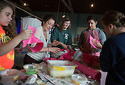 From left: Emily Anderson, Christa Cocumelli, Monet Poulin, Paul Brydbord, and Allyson Kuehn work on a puppet for Honey of the Heart at the Central Avenue Venue on Oct. 15, 2014. Photo by Lauren Pond