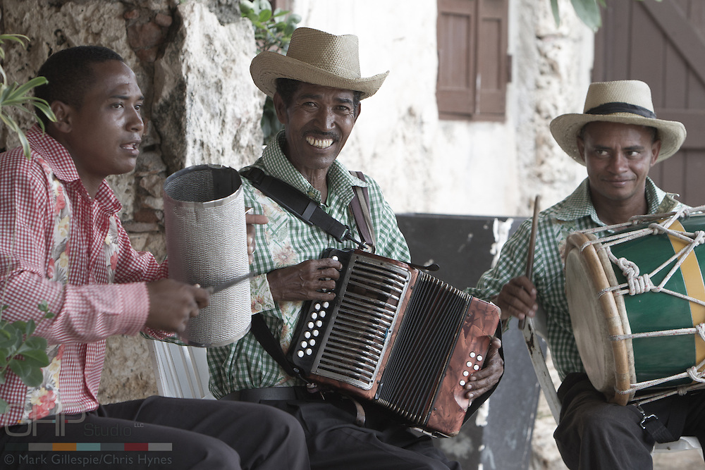 Musicians in the Dominican Republic play the accordion and percussion instruments.