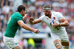 England Flanker Tom Wood hands off Ireland Fly-Half Johnny Sexton - Mandatory byline: Rogan Thomson/JMP - 07966 386802 - 05/09/2015 - RUGBY UNION - Twickenham Stadium - London, England - England v Ireland - QBE Internationals 2015.
