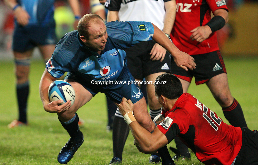 Gary Botha looks to bust the tackle of Sonny Bill Williams.<br /> Investec Super Rugby - Crusaders v Bulls, 9 April 2011, Alpine Energy Stadium, Timaru, New Zealand.<br /> Photo: Rob Jefferies / www.photosport.co.nz