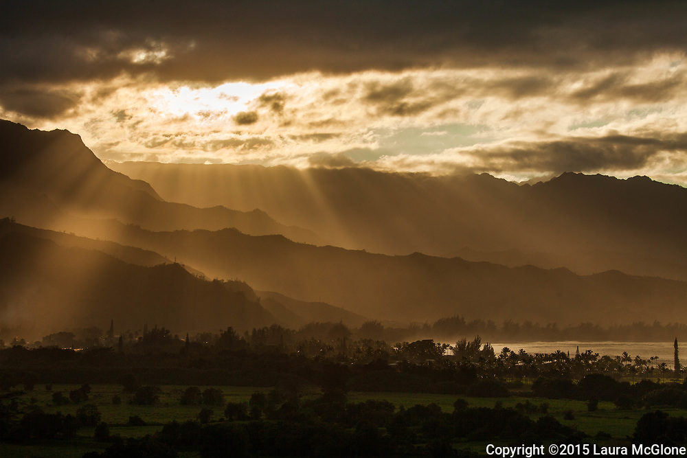 Light coming through clouds onto layered mountains, Kauai, Hawaii