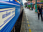 31 MAY 2017 - CHACHOENGSAO, THAILAND: A passenger walks to a waiting Bangkok bound train at the train station in Chachoengsao, a provincial town about 50 miles and about an hour by train from Bangkok. The train from Chachoengsao to Bangkok takes a little over an hour but traffic on the roads is so bad that the same drive can take two to three hours. Thousands of Thais live outside of Bangkok and commute into the city for work on trains, busses and boats.       PHOTO BY JACK KURTZ