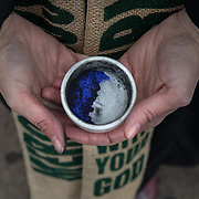 "ALEXANDRIA, VA - MAR1: Pastor Robin Anderson, from  Commonwealth Baptist church, gives out ""glitter ashes"" for Ash Wednesday, outside the Braddock Road metro station, in Alexandria, VA, March 1, 2017. Across the country, churches involved with the advocacy group Parity will be giving out ""glitter ashes"" to demonstrate that LGBT people should be included in Christianity.(Photo by Evelyn Hockstein/For The Washington Post)"