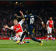 Jack Wilshere of Arsenal and Sadio Man&eacute; of Southampton during the Capital One Cup match at the Emirates Stadium, London<br /> Picture by David Horn/Focus Images Ltd +44 7545 970036<br /> 23/09/2014
