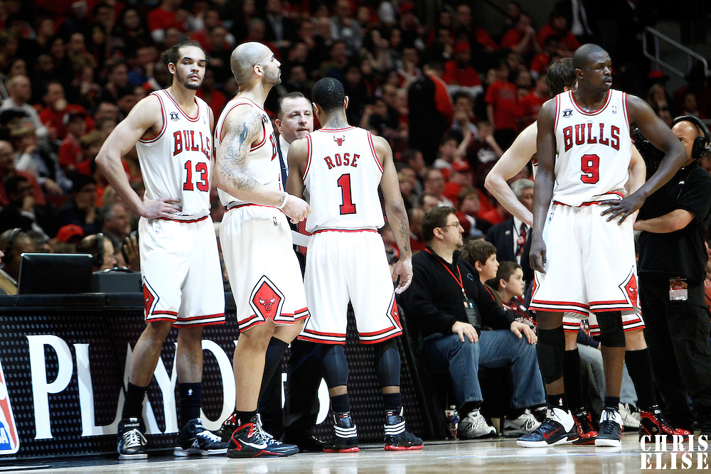 16 April 2011: Chicago Bulls center Joakim Noah (13), Chicago Bulls power forward Carlos Boozer (5), Chicago Bulls point guard Derrick Rose (1) and Chicago Bulls small forward Luol Deng (9) are seen during the Chicago Bulls 104-99 victory over the Indiana Pacers, during the game 1 of the Eastern Conference first round at the United Center, Chicago, Illinois, USA.