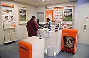 Nederland, Millingen, 4-5-2012Postkantoor in een supermarkt. De baliejuffrouw is een werknemer van de c1000.Foto: Flip Franssen/Hollandse Hoogte