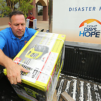 Steve Tybor, Executive Director with Eight Days of Hope, loads a generator in their truck that had been donated earlier in the day on Monday at the BancorpSouth Arena. Eight Days of Hope will be taking donations until Wednesday of power equipment and power related items to assist in the recovery process in Houston Texas.