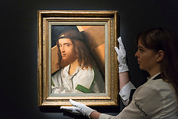 "© Licensed to London News Pictures. 29/11/2019. LONDON, UK. A technician presents ""Christ carrying the Cross"", by Giovanni Bellini (Est. GBP150-200k) at the preview of Old Masters sales at Sotheby's, New Bond Street.  Works will be offered for sale on 4 and 5 December.  Photo credit: Stephen Chung/LNP"