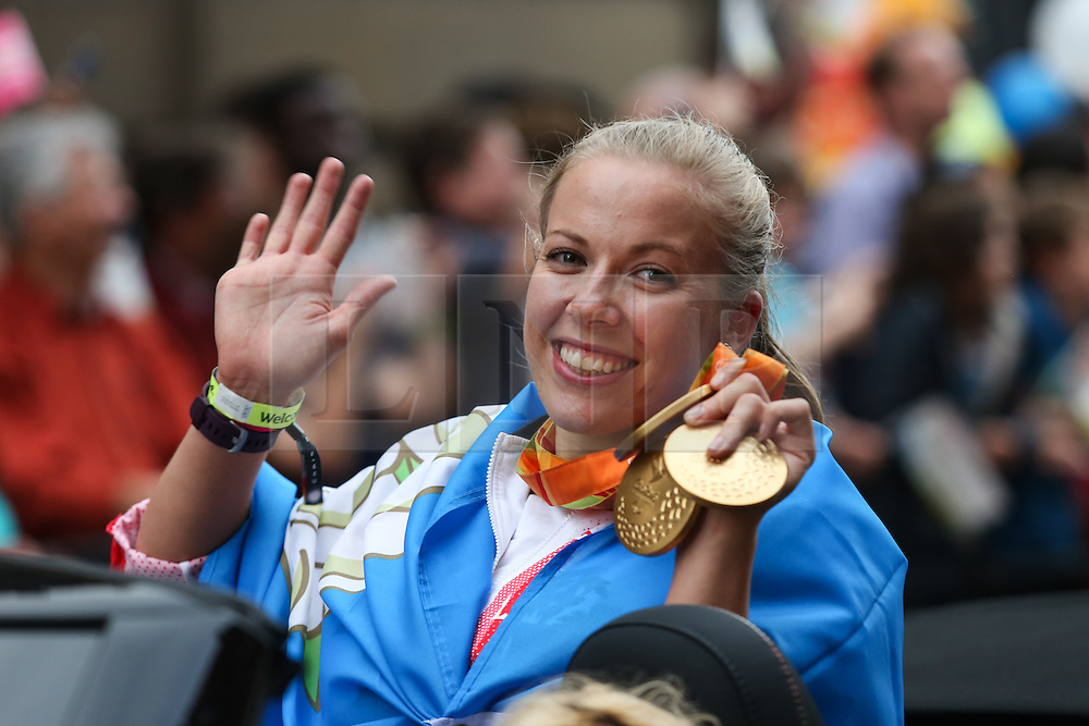 © Licensed to London News Pictures. 28/09/2016. Leeds, UK.  Medalist Hannah Cockcroft waves to the crowd during the Olympic and Paralympic parade in Leeds. Yorkshire's Olympic and Paralympic stars receive a heroes' welcome during an open top bus parade in Leeds, West Yorkshire. . Photo credit : Ian Hinchliffe/LNP