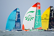 Telefonica, Groupama, and Abu Dhabi Ocean Racing under spinnaker at the 2011-2012 Volvo Ocean Race Miami in-port race.