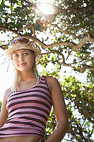 Young woman in sun hat outdoors half length