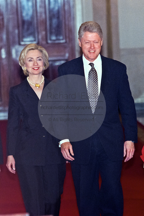 President and Mrs. Clinton enter the East Room for the Millennium evening lecture on 'Women as Citizens' in the White House March 15, 1999. The Clinton's appeared together for the first time since rumors of marital separation.