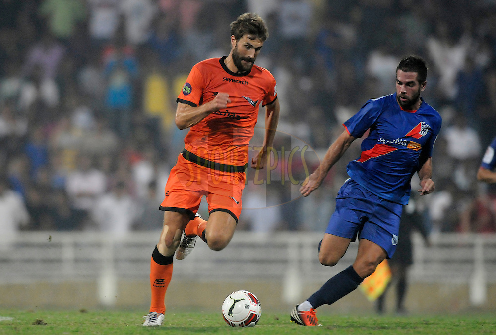 Morten Skoubo of Delhi Dynamos FC and Johan Letzelter of Mumbai City FC run with the ball during match 22 of the Hero Indian Super League between Mumbai City FC and Delhi Dynamos FC City held at the D.Y. Patil Stadium, Navi Mumbai, India on the 5th November.<br /> <br /> Photo by:  Pal Pillai/ ISL/ SPORTZPICS