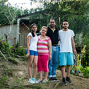 JULY 19, 2018----UTUADO, PUERTO RICO---<br /> From left;  Ledianne Ruiz-Vera, 20, Diana Ivelisse Vera Maldonado, 44,  Jose Ruiz Gonzalez, 45, and Byron Joxel Ruiz, 14 in front of their house with the power line that has been disconnected since the path of Hurricane Maria on September 20, 2018.<br /> (Photo by Angel Valentin/Freelance)