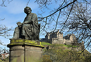 Statue of Sir James Young Simpson, 1811-70, obstetrician and pioneer of anaesthesia, by William Brodie, 1815-81, in West Princes St Gardens, Edinburgh, Scotland. Behind is Edinburgh Castle on Castle Rock. The first royal castle built here was under David I in the 12th century, and the site has been built on, attacked and defended ever since. The castle now houses military museums and the National War Museum of Scotland and is run by Historic Scotland. Picture by Manuel Cohen