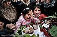 SYRIA - Al Qsair. A child  (c) mourning his father, who was kidnapped by shabiha (militias of the regime) during three days with other two men. He was tortured and they abandoned the bodies in a main street of Al  Qsair, on February 14, 2012. ALESSIO ROMENZI