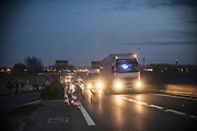February 29, 2016 - Calais, France - <br /> <br /> Demonstration under high tension in Calais, France<br /> <br /> Some migrants are blocking the bypass port and threw stones at the trucks. In Calais, Northern France, february 29, 2016  <br /> ©Exclusivepix Media