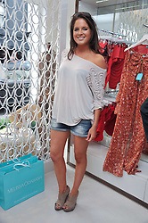 ALEXANDRA 'BINKY' FELSTEAD from TV's Made in Chelsea at the opening of the new Melissa Odabash store in Walton Street, London SW3 on 7th July 2011.