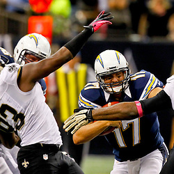 October 7, 2012; New Orleans, LA, USA; New Orleans Saints defensive end Junior Galette (93) and defensive end Cameron Jordan (94) pressure San Diego Chargers quarterback Philip Rivers (17) for a sack during the fourth quarter of a game at the Mercedes-Benz Superdome. The Saints defeated the Chargers 31-24. Mandatory Credit: Derick E. Hingle-US PRESSWIRE