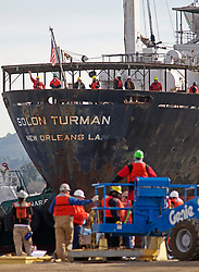 Crew members wave from the deck during the arrival of the Solon Turman,  to the newly re-opened dry docks located on Mare Island in Vallejo, Calif.  California Dry Dock Solutions was recently awarded a $3.1 Million contract from the U.S.Navy to dismantle two ships  currently located in Suisun Bay.