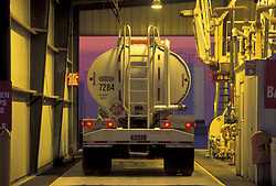 Large liquid transport truck parked in the garage being weighed