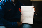 VALLEY GRANDE, AL – FEBRUARY 7, 2019: Maury Davis, 51, holds a letter written by his best friend, Jeff Williams, which Davis received while serving a prison sentence. On June 28, 1992, at age 12, Davis accidentally shot his best friend as the two were playing with a handgun in his family's Bronx apartment. The injury left his friend paralyzed for life. Despite the trauma, Davis and his friend, Jeff Williams, maintain an enduring friendship. CREDIT: Bob Miller for The New York Times