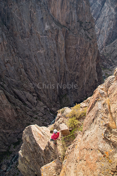 "Kate Rutherford belaying during an ascent of the ""Free Nose,"" 12c, North Rim, Black Canyon of the Gunnison."
