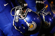 San Jose State Spartans hold their helmets on the sidelines during the season opener against the Sacramento State Hornets at San Jose State University's Spartan Stadium in San Jose, California, on August 29, 2013. (Stan Olszewski/ZUMA Press)