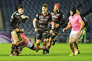 Blair Kinghorn under pressure during the European Rugby Challenge Cup match between Edinburgh Rugby and Stade Francais at Murrayfield Stadium, Edinburgh, Scotland on 12 January 2018. Photo by Kevin Murray.