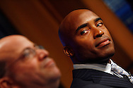 "Former New York Giants running back Tiki Barber listens as NBC President and CEO Jeff Zucker(L) speaks to members of the media as he is introduced as a news correspondent for NBC's ""The Today Show"" in New York, February 13, 2007. Barber will also be a sports analysts for NBC's ""Football Night in America""."