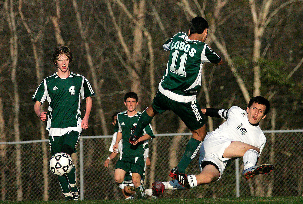 Robert E. Lee's Abdiel Palomo (14) and Longview's Daniel Peralta (11) battle for the ball as Lobo Andy Newton (4) looks on during a District 12-5A soccer match at the REL soccer field on Tuesday, March 11, 2008.