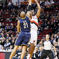 02 December 2013: Portland Trail Blazers power forward LaMarcus Aldridge (12) takes a jumpshot over Indiana Pacers power forward David West (21) during the Portland Trail Blazers 106-102 victory over the Indiana Pacers at the Moda Center, Portland, Oregon, USA.