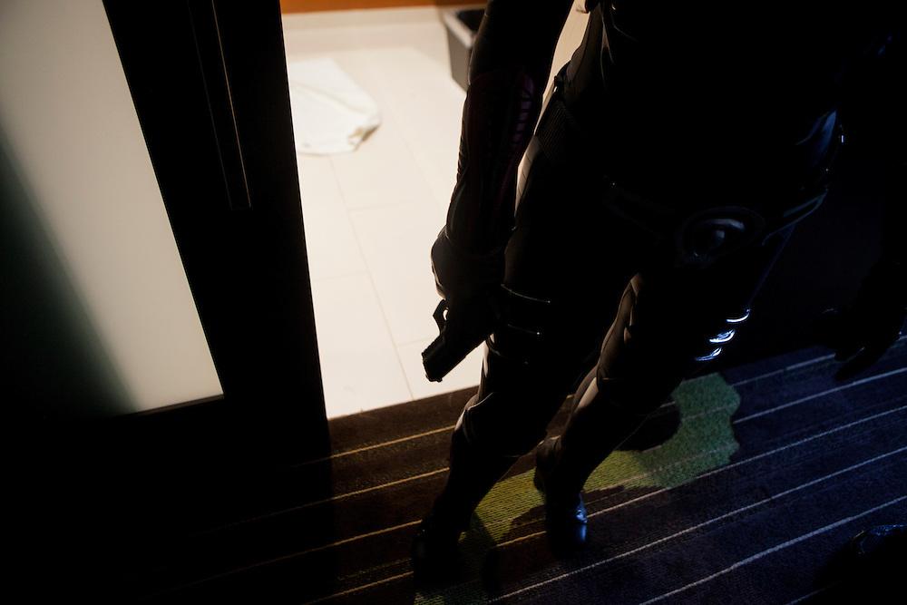 Cosplayer Yaya Han grabs her gun in preparation for portraying Baroness from G.I. JOE.